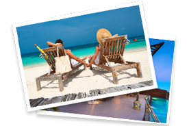 wooden deck chairs on beach with woman in hat lay on top of one