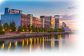 salford quays at night with orange and red sunset