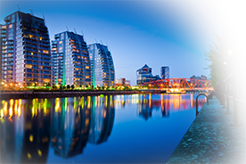 media city at night next to the canal