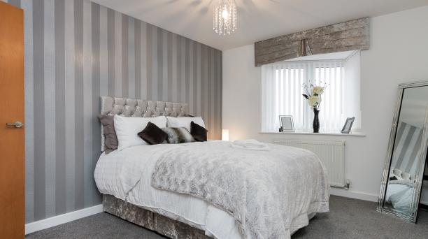 styish double bedroom, grey feature wall