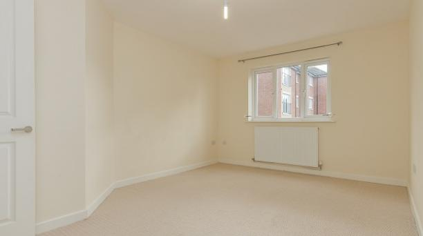 unfurnished beige bedroom