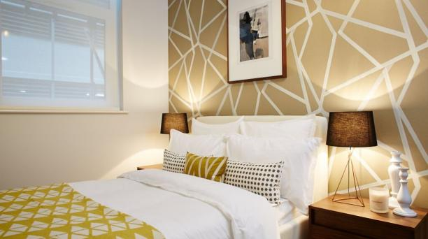 double bedroom, yellow feature wall, large double wall