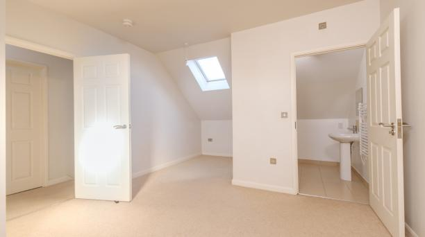 white bedroom with ensuite in buy to let property investment