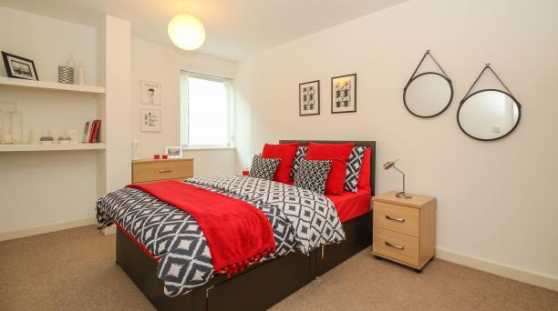 white bedroom, cream carpet, double bed, light oak furnishings