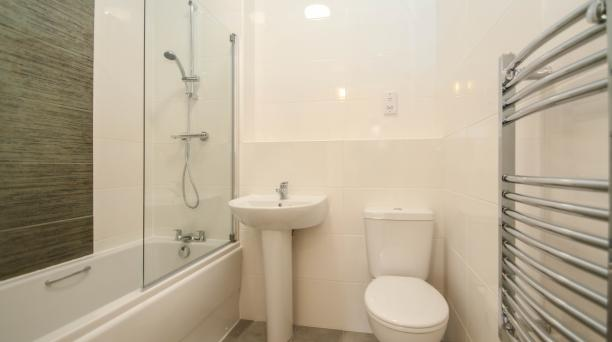 white bathroom, bath and shower combined