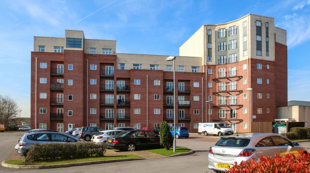 buy to let investment in salford, block of flats 6 stories high with car parking in front of the building