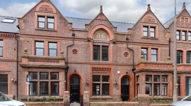3 story buy to let property, large gothic style brick building with 2 central windows and 3 large windows either side.