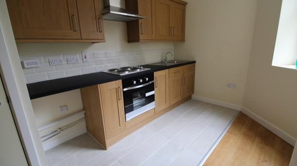 kitchen, built in oven and hob, dark worktops, oak cupboards
