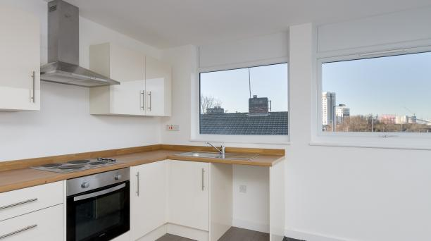 white kitchen, white tiles and cupboards, built in oven
