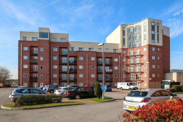 buy to let property in salford, block of flats 6 floors high with car parking in front