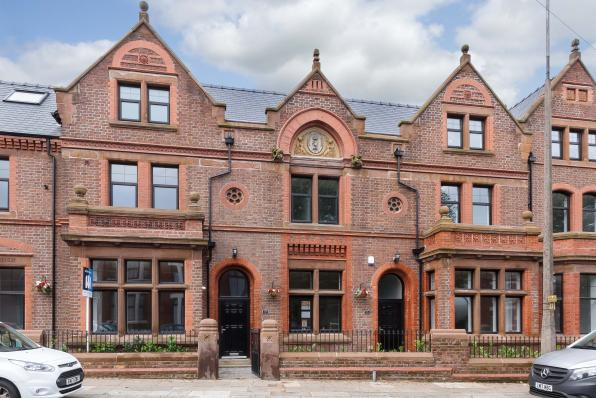 gothic style buy to let property investment, 3 storeys high with large windows, 2 central and 3 either side