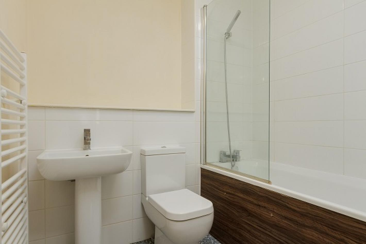 Bathroom beige and white tiled walls