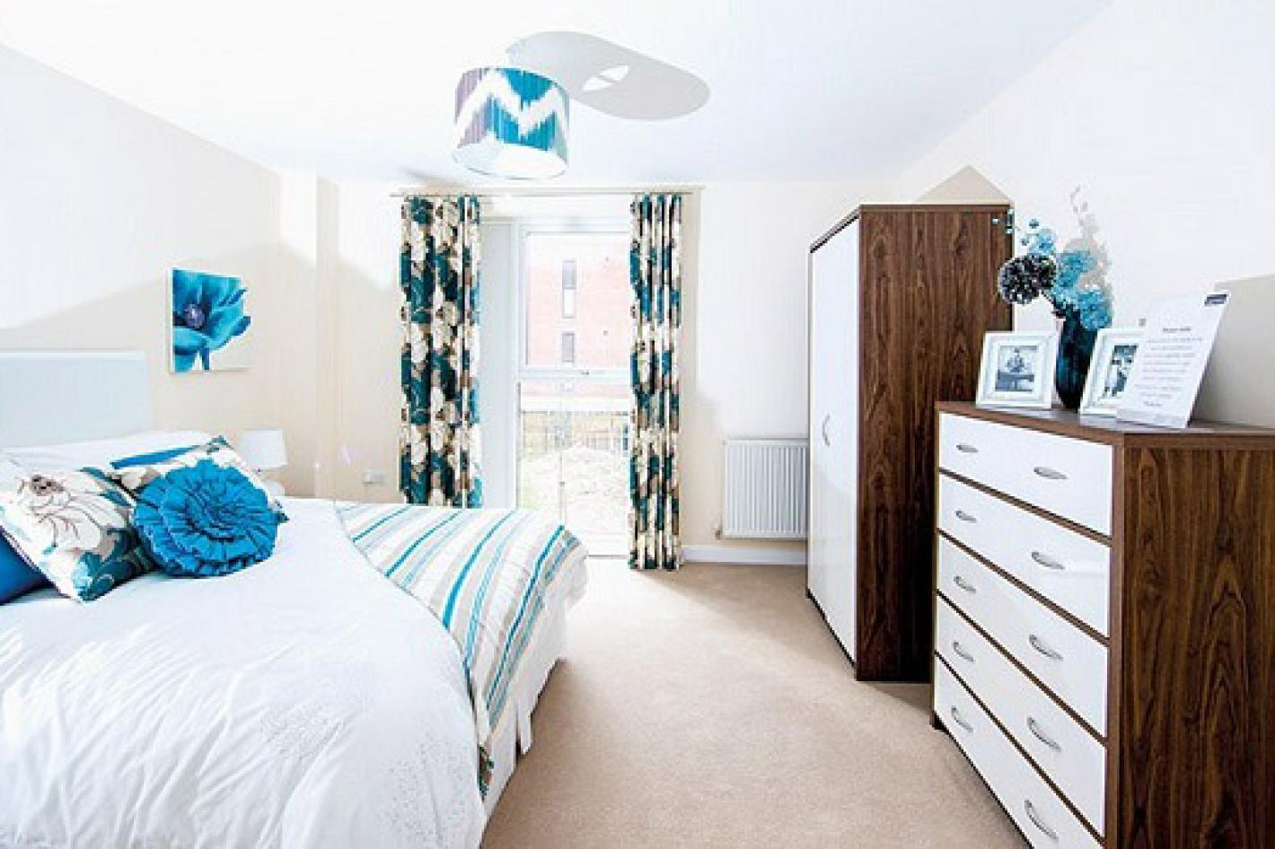 white bedroom with single floor to ceiling window