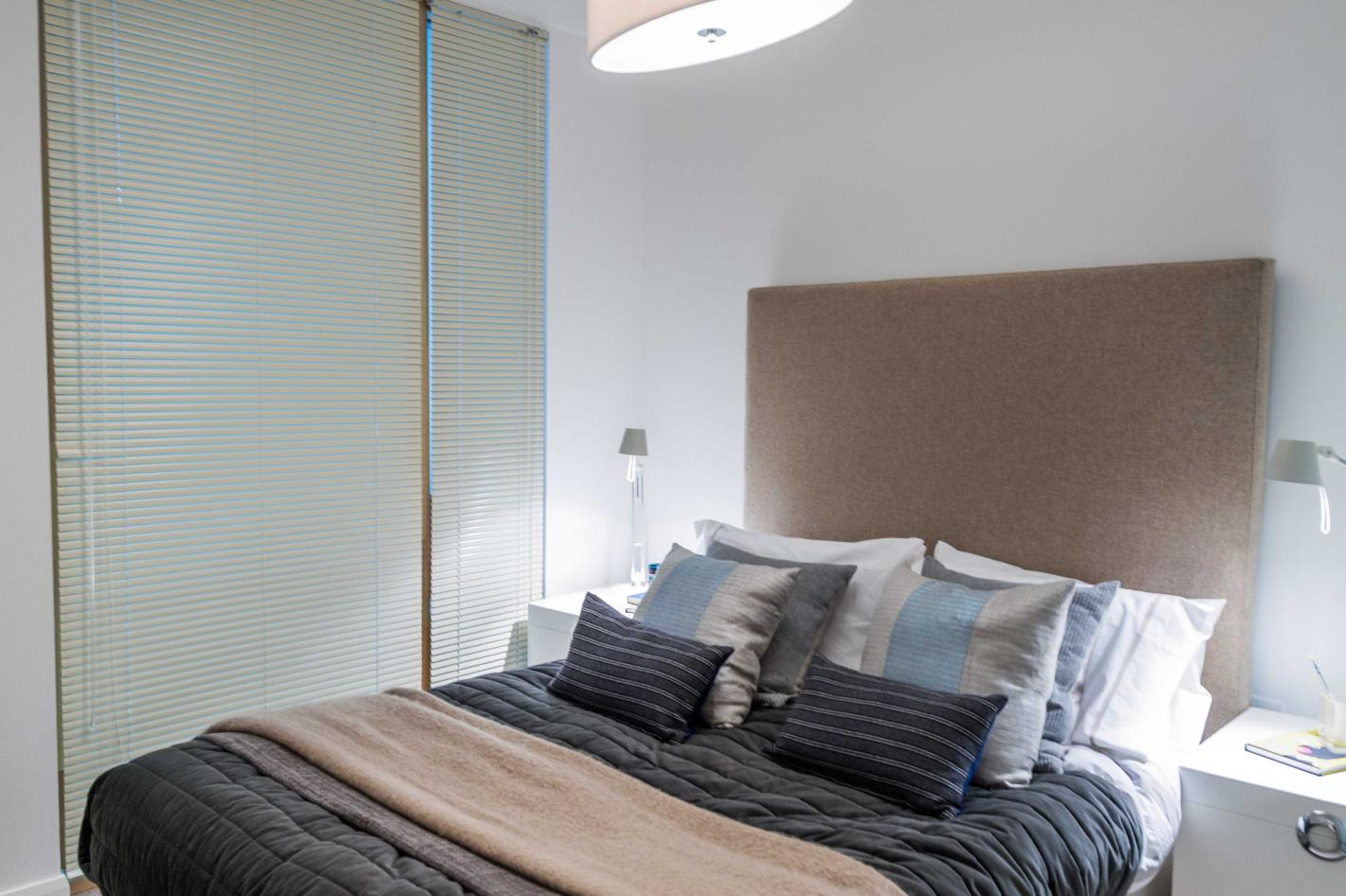 double bedroom with floor the ceiling sliding wardrobes