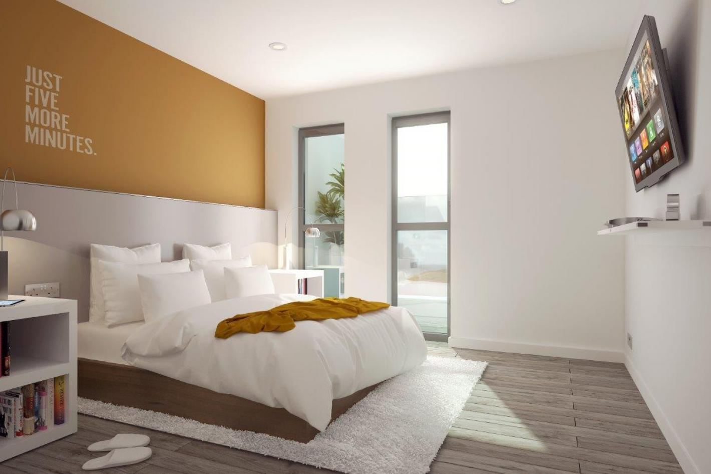 modern double bedroom, tall windows, yellow feature wall