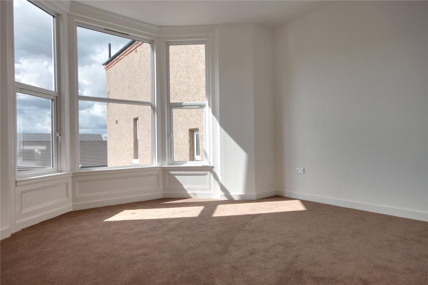 white walls, brown carpet, triple window