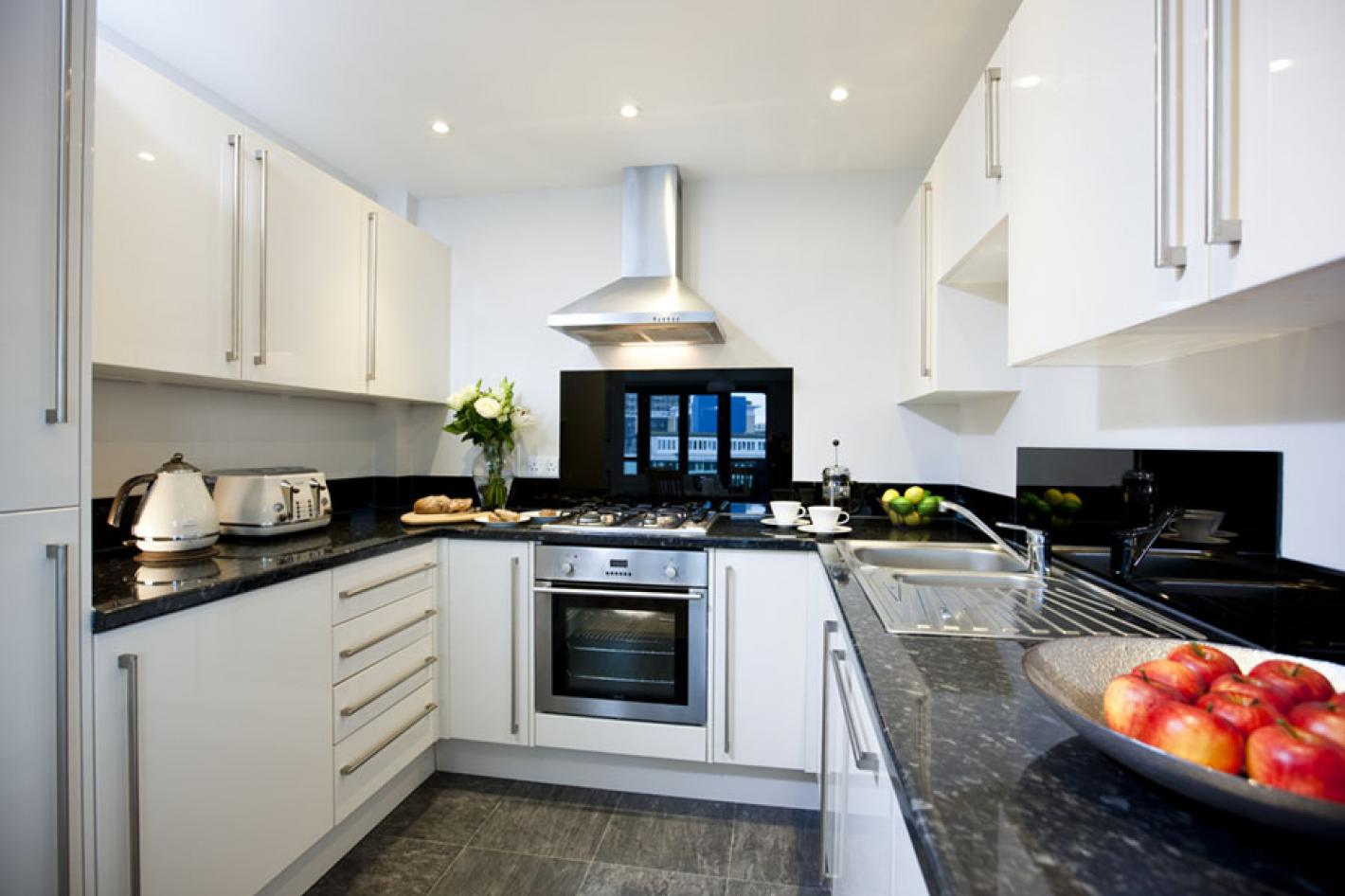 black and white kitchen, granite work tops, built in oven