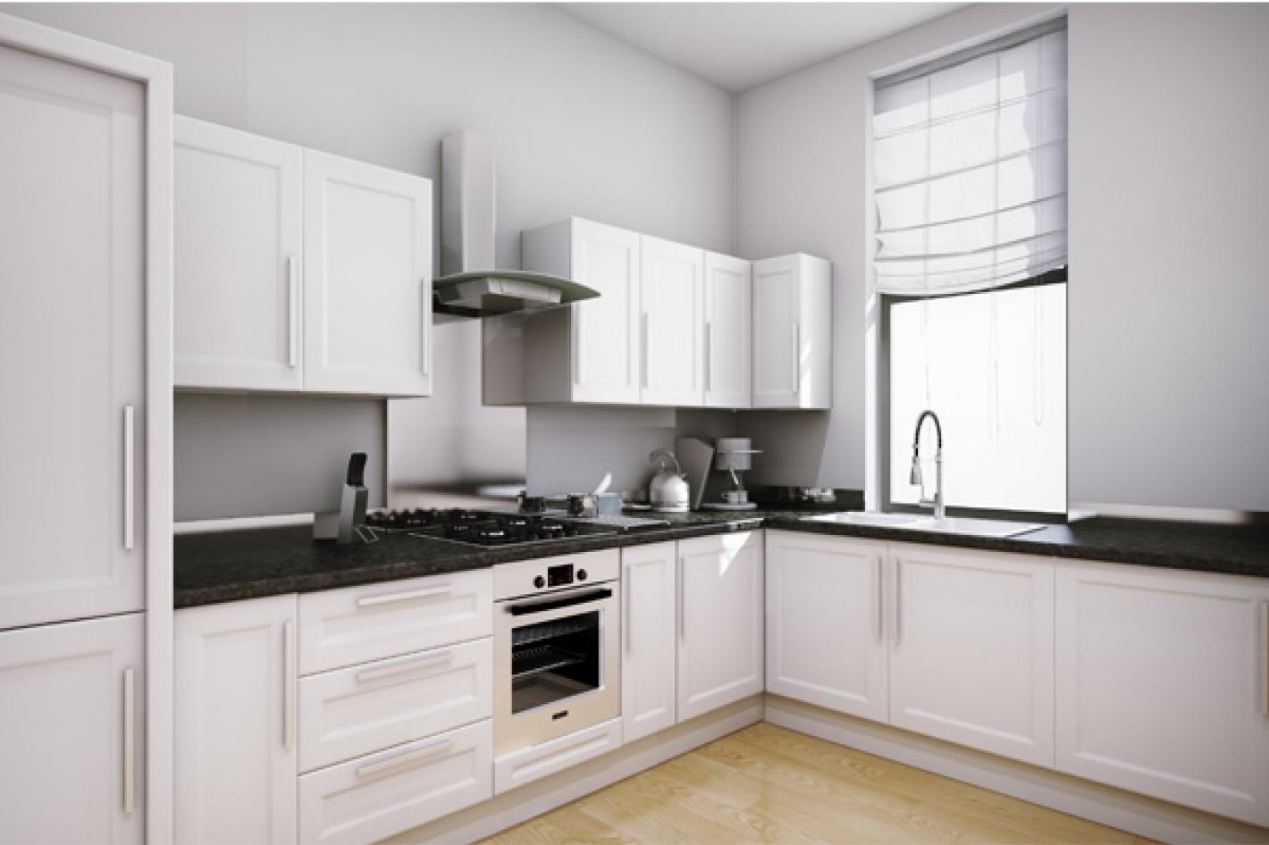 white kitche with white furnishings and a built in oven