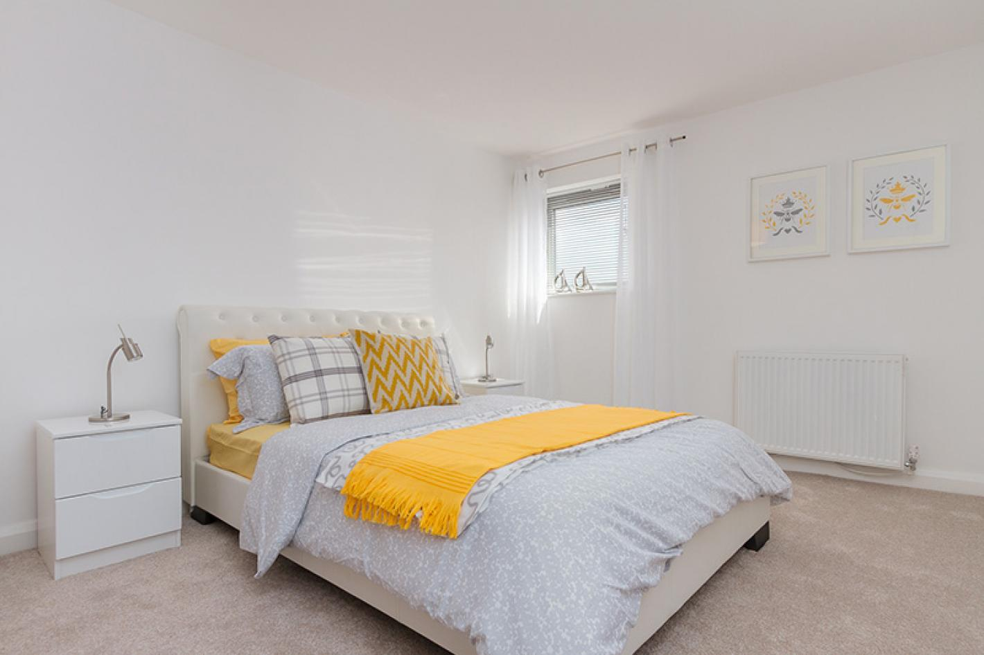 double bedroom with white walls
