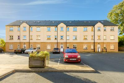 3 story high buy to let property investment with car parking in front, modern style flats