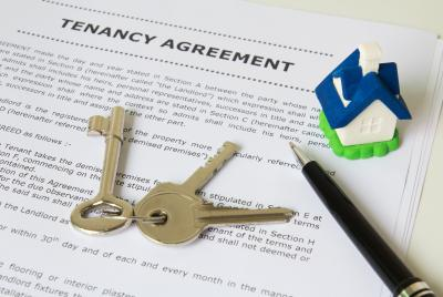 tenancy agreement with keys on top of it