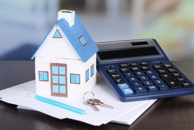 model of house next to calculator