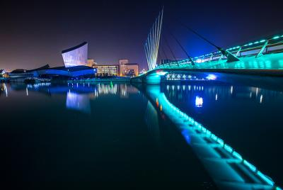 salford at night over looking the quays and bridge