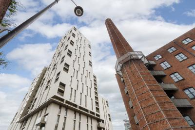 buy to let investment in liverpool, large white skyscraper next to a victorian style mill